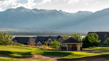 Panorama frame Golf course and residential area overlooking the lake mountain and valley