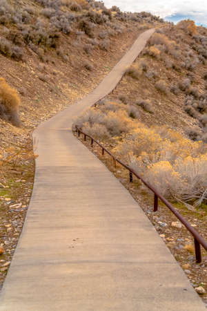 Steep footpath or hiking trail climbing a mountain