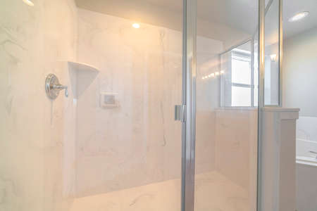White marble bathroom shower with glass screen
