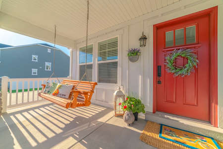 Front porch of alternative home and swinging chair