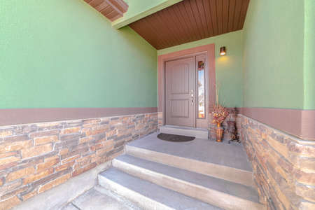 Front porch and door of traditional green home