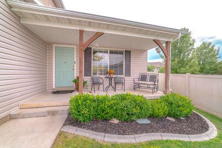 Front veranda of modern home and landscaped garden Standard-Bild