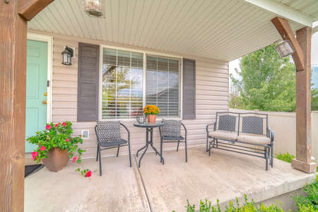 Front veranda of modern home and outdoor furniture