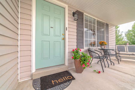 Front door of suburban home with welcome mat