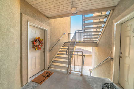 Front door of apartment from exterior stairwell
