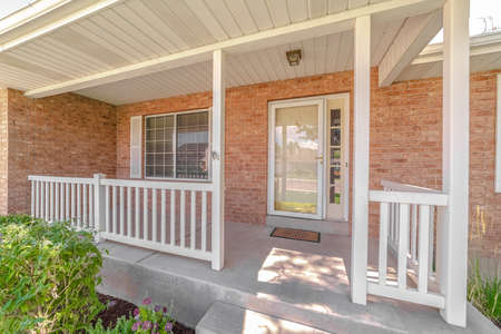 Front porch and door of traditional brick home