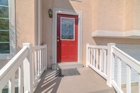 Red front door and steps of traditional home