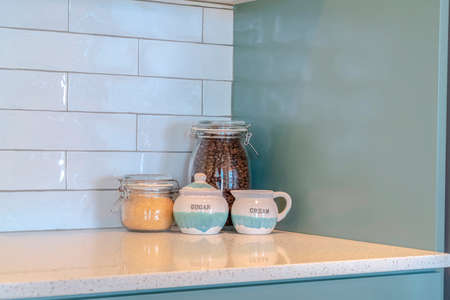 Glass storage jars with coffee and sugar