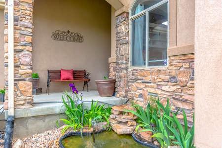 Small ornamental pond outside a house outside