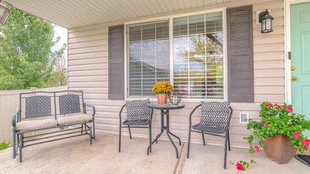 Panorama frame Front veranda of modern home and outdoor furniture. The front veranda of a modern, suburban home with outdoor furniture.