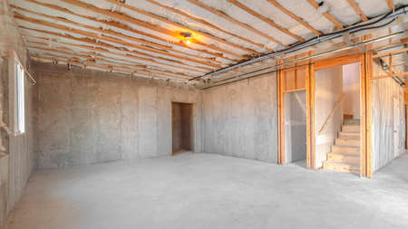 Panorama frame Interior of new home room under construction. The interior of a new home room under construction showing studs and insulation.