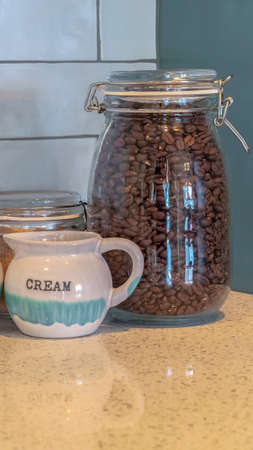 Vertical frame Coffee and sugar in glass storage bottles