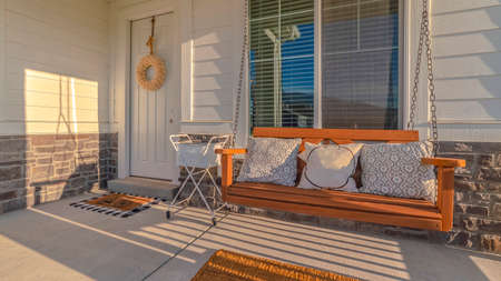 Panorama frame Front veranda of modern home with swinging chair