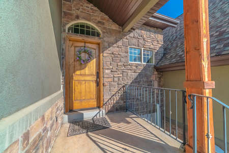 Entrance to a property with feature brick wall