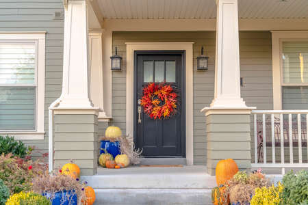 Colorful autumn wreath hanging on a front door Stock Photo
