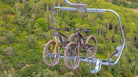 Panorama Close up of chairlifts with mountain bikes in Park City ski resort at off season. Lift accessed mountain biking with hiking trails in summer.