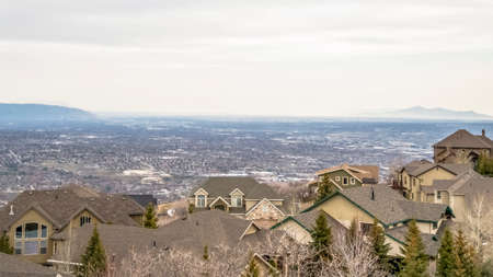 Panorama frame Aerial view of houses in the valley with mountain and horizon in the distance 스톡 콘텐츠