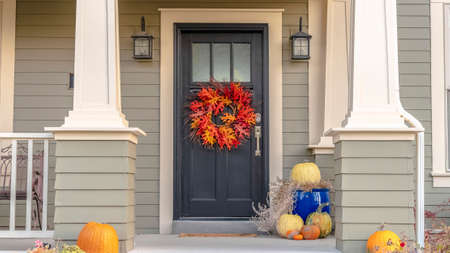 Panorama frame Colorful autumn wreath hanging on a front door