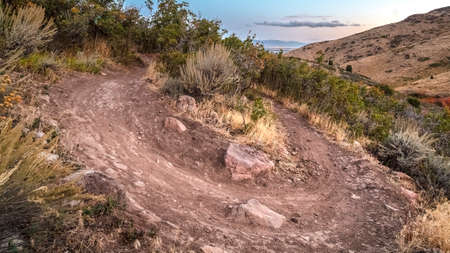 Panorama frame Hiking trail making a sharp U-bend turn. Hiking trail making a sharp U-bend turn on the mountains in Utah in a scenic landscape