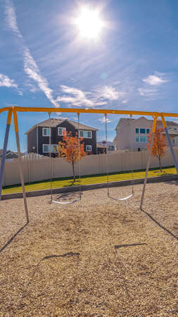 Vertical frame Set of A-frame swings on a kids playground
