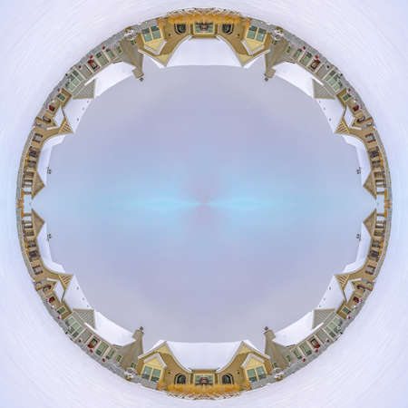 Circular design made from a winter village with fresh snow covering everything