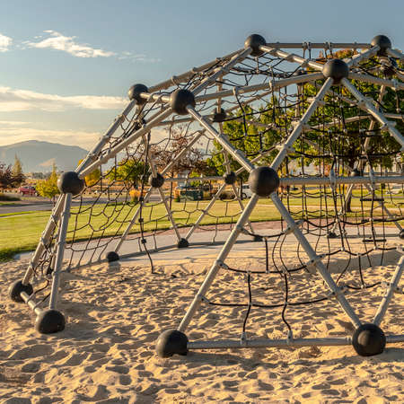 Square frame Metal climbing dome with nets in a playground Zdjęcie Seryjne