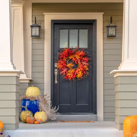 Square frame Colorful autumn wreath hanging on a front door