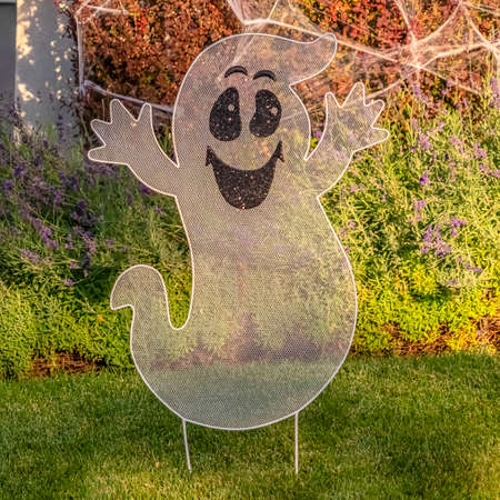 Square frame Ghost with cobwebs decoration in a garden