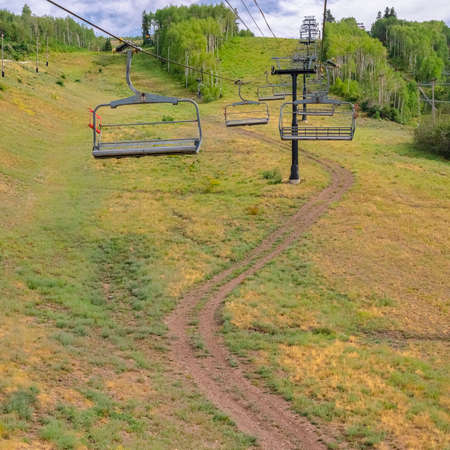 Square frame Summer at Park City ski resort with chairlifts over winding hiking trails
