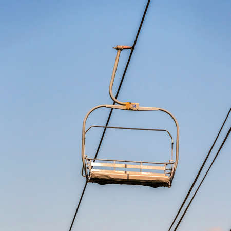 Square Chairlifts in Park City Utah ski resort against cloudy sky during off season Zdjęcie Seryjne