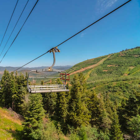 Square Metal chairlift against aerial view of mountain in Park City Utah at off season
