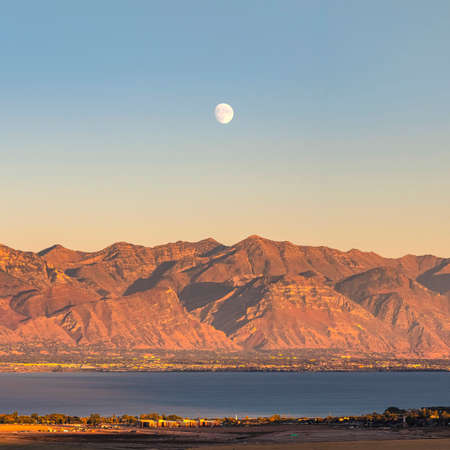 Square frame Moon rising over Provo Canyon, Utah Lake