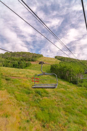 Summer landscape of ski resort in Park City Utah with chairlifts and trails