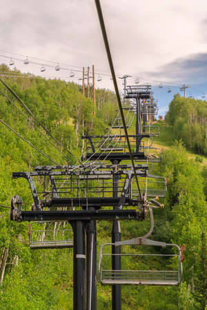 Row of chairlifts on cables as transportation at a ski resort in Park City Utah