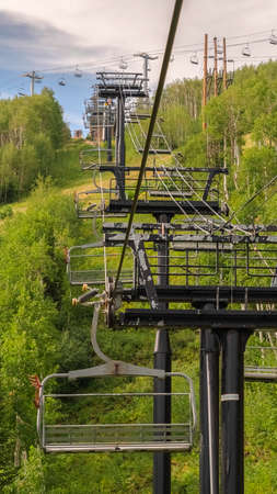 Vertical Row of chairlifts on cables as transportation at a ski resort in Park City Utah