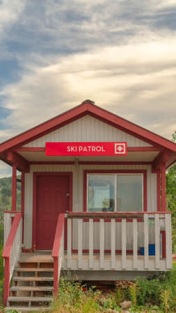 Vertical frame Ski Patrol wooden building with stairs and porch in Park City Utah in summer