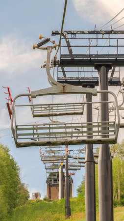 Vertical frame Off season in Park City Utah with chairlifts and trails on a mountain landscape