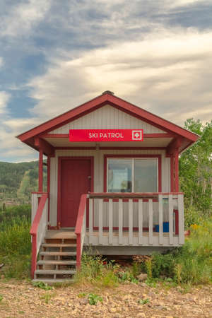 Ski Patrol wooden building with stairs and porch in Park City Utah in summer