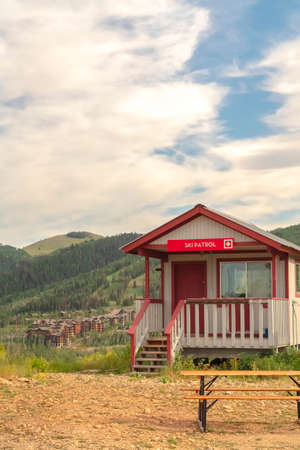 Off season in Park City with Ski Patrol cabin against mountain and cloudy sky