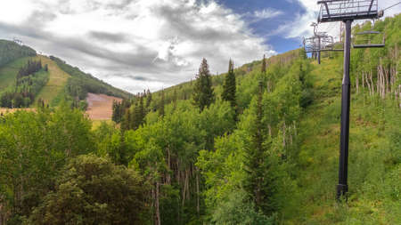 Panorama frame Mountain covered with rich green trees during summer in Park City ski resort Zdjęcie Seryjne