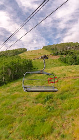 Vertical Summer landscape of ski resort in Park City Utah with chairlifts and trails