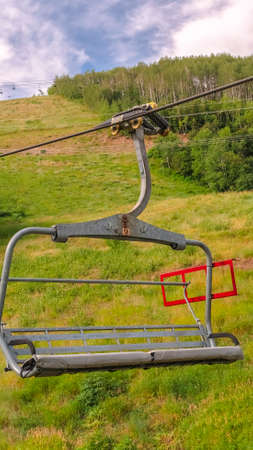 Vertical frame Scenic off season landscape with chairlifts and trails in Park City Utah