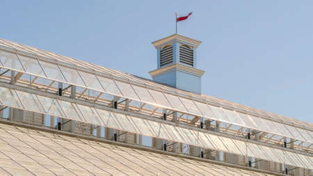 Panorama Close up of roof of a greenhouse with glass panels against sky on a sunny day Zdjęcie Seryjne