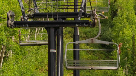 Panorama frame Row of chairlifts on cables as transportation at a ski resort in Park City Utah Zdjęcie Seryjne