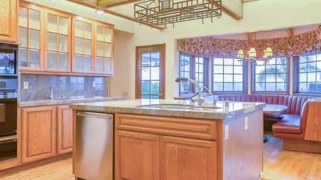 Panorama frame Well lit, open and warm kitchen with vaulted ceilings. Wonderful California home in San Diego county. Real estate listings with powerful visuals. Stock Photo