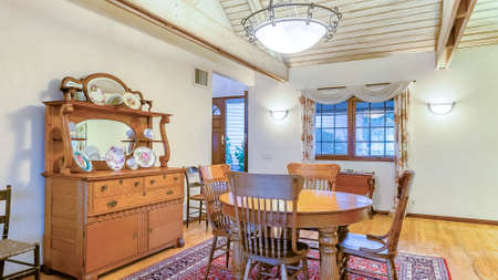 Panorama Bright, open and warm dining room with vaulted ceilings. Wonderful California home in San Diego county. Real estate listings with powerful visuals.