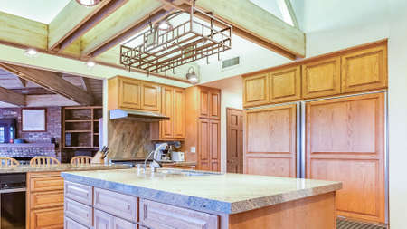 Panorama frame Bright, open and warm kitchen with vaulted ceilings and island with spotlights. Wonderful California home in San Diego county. Real estate listings with powerful visuals.