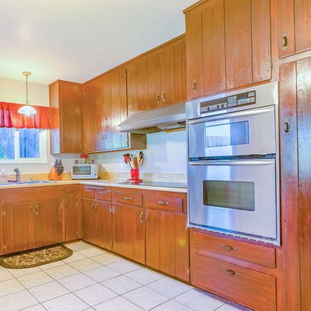 Square frame Spacious kitchen with plenty of amenities, square tile floor and warm lighting. Wonderful California home in San Diego county. Real estate listings with powerful visuals.