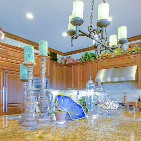Square Model home kitchen in southern California with granite counter tops. Wonderful California home real estate listings with powerful visuals.