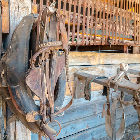 Square frame Close up of old and dirty horse saddle with rusty metal and damaged leather